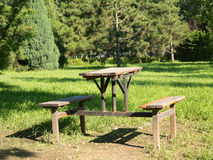 Picnic table. A old wooden picnic table in a grassy field Royalty Free Stock Images
