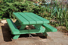 Picnic Table. Green picnic table on a sunny day Royalty Free Stock Photos