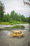 Picnic Table in Alaska Wilderness Stock Image