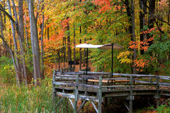 Picnic table in the autumn Stock Images