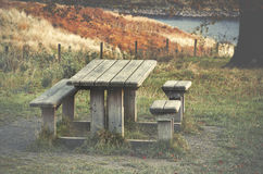 Picnic table, autumnal colours of trees at Peak District,  Doves. Tone Reservoir, England, UK Stock Image
