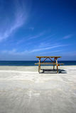 Picnic table on beach Stock Photography