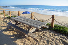 Picnic table on beach in the Crystal Cove State Park. Royalty Free Stock Photo