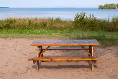 Picnic table at a beach Stock Photos