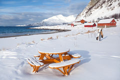 Picnic table on the beach, winter Norway scenery Royalty Free Stock Photo