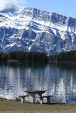 Picnic table. With a beautiful lake and mountain Stock Photography