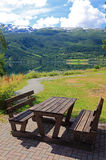 Picnic table and benches near lake. Royalty Free Stock Photos