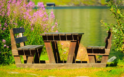 Picnic table and benches near lake in Norway, Europe. Stock Photos