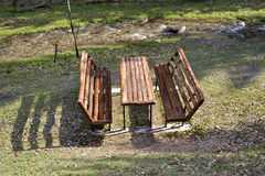 Picnic table and benches in the park. Stock Photo