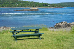 Picnic table with coast in background Royalty Free Stock Photos
