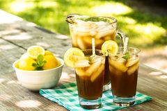 Picnic Table With Cold Iced Tea And Lemons Royalty Free Stock Images