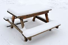Picnic table covered with snow. On snow-covered terrace Royalty Free Stock Images