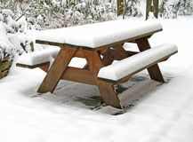 Picnic table covered with snow. On snow-covered terrace Stock Image