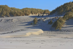 Picnic table in dunes at Ameland Island, Holland Stock Photography