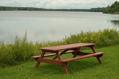 Pinic table on the lakeshore. Picnic table on the edge of Howard Eaton reservoir in Northwestern Pennsylvania royalty free stock photo
