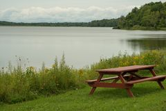 Pinic table on the lakeshore. Picnic table on the edge of Howard Eaton reservoir in Northwestern Pennsylvania Royalty Free Stock Photos