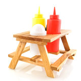 Picnic table for fast food. Wooden picnic table for fast food with tomato sauce and mustard Stock Photography