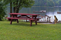 Picnic table in front of pond in the rain Stock Photography