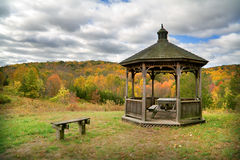 Picnic Table and Gazebo. View of gazebo with picnic table with fall foliage Royalty Free Stock Photography