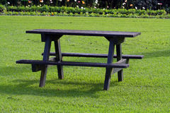 Picnic table on grass. Wooden picnic table on the grass Stock Photos