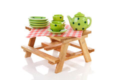 Picnic table with green dotted tablewear Stock Photography