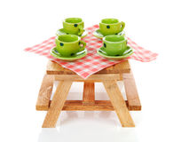 Picnic table with green dotted tablewear Royalty Free Stock Photography