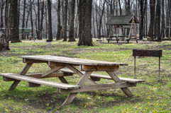 Picnic table on a green meadow stock images