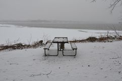 Picnic table with ice and snow and Wilson bridge and the Potomac river stock photo