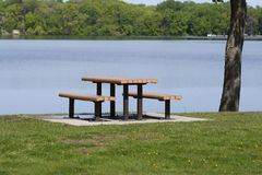 Picnic table by lake Stock Image