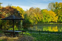 Picnic table by the lake surrounded by the forest in autumn colors, Belgrade Royalty Free Stock Photography