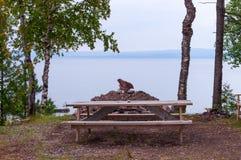 Picnic table at a lake Stock Photo