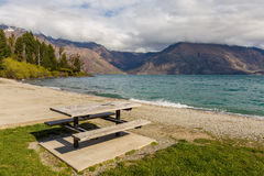 Picnic table by the lake Royalty Free Stock Photos