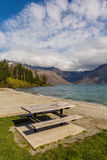 Picnic table by the lake Stock Photos