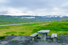 Picnic table and landscape near the Isafjordur fjord Royalty Free Stock Images