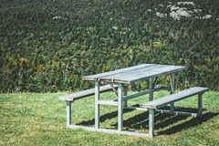 Picnic table on a mountain slope stock photo