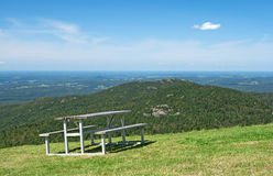 Picnic table in mountains Stock Image