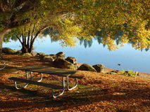A picnic table near a lake. Royalty Free Stock Photo
