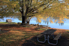 A picnic table near a lake. Stock Images