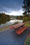 Picnic table near the lake. Royalty Free Stock Photos