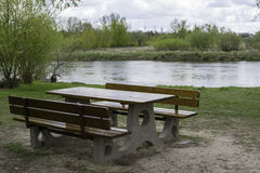 Picnic table near a river. Picnic table near the Warta river royalty free stock photography