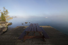 Picnic Table with No People on a Dock. During a Foggy Calm Morning royalty free stock photos