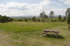 Picnic Table Overlooking Distant Mountains Royalty Free Stock Photos