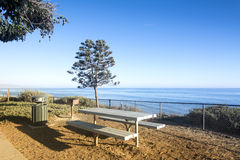 Picnic table overlooking ocean Stock Photo