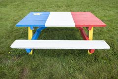 Picnic Table Painted with Colors of the Acadian Flag #2 royalty free stock photos
