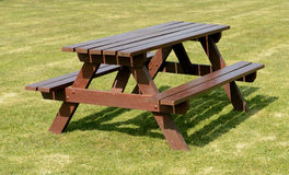 Picnic table. A park picnic table  on green grass background Royalty Free Stock Photo
