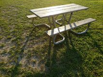 Picnic table. In a park lit by sun Stock Photo