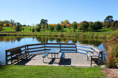 Picnic table by the pond Royalty Free Stock Photos
