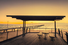 Picnic table at Port Noarlung during sunset Royalty Free Stock Images