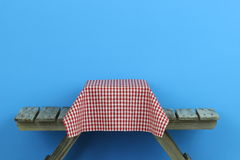 Picnic table with red gingham tablecloth Stock Photos