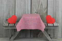 Picnic table with red hearts and tablecloth Royalty Free Stock Photography